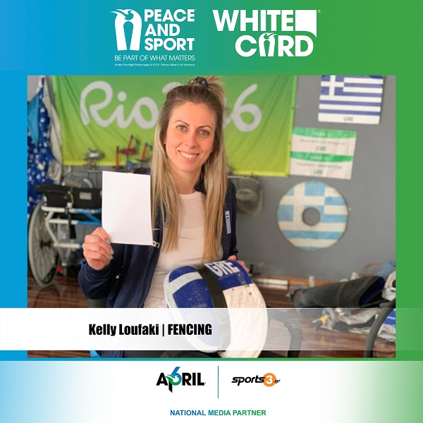 "Kelly Loufaki raises the White Card for the ""Peace and Sport"" movement, giving a message for world peace."